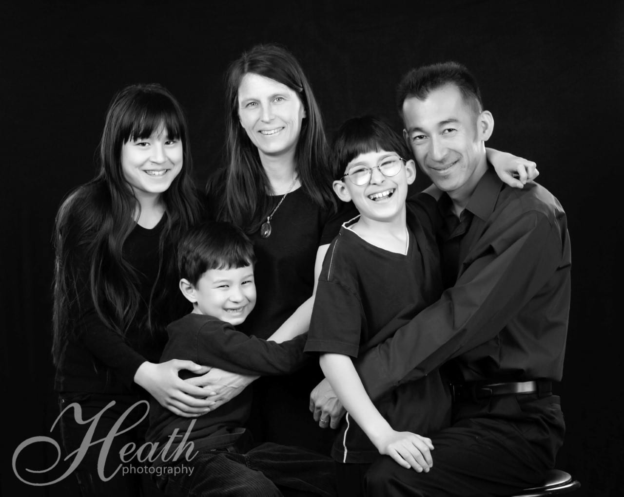 FAMILY SESSION PACKAGE  Donated by: HEATH PHOTOGRAPHY  Valued at: $390