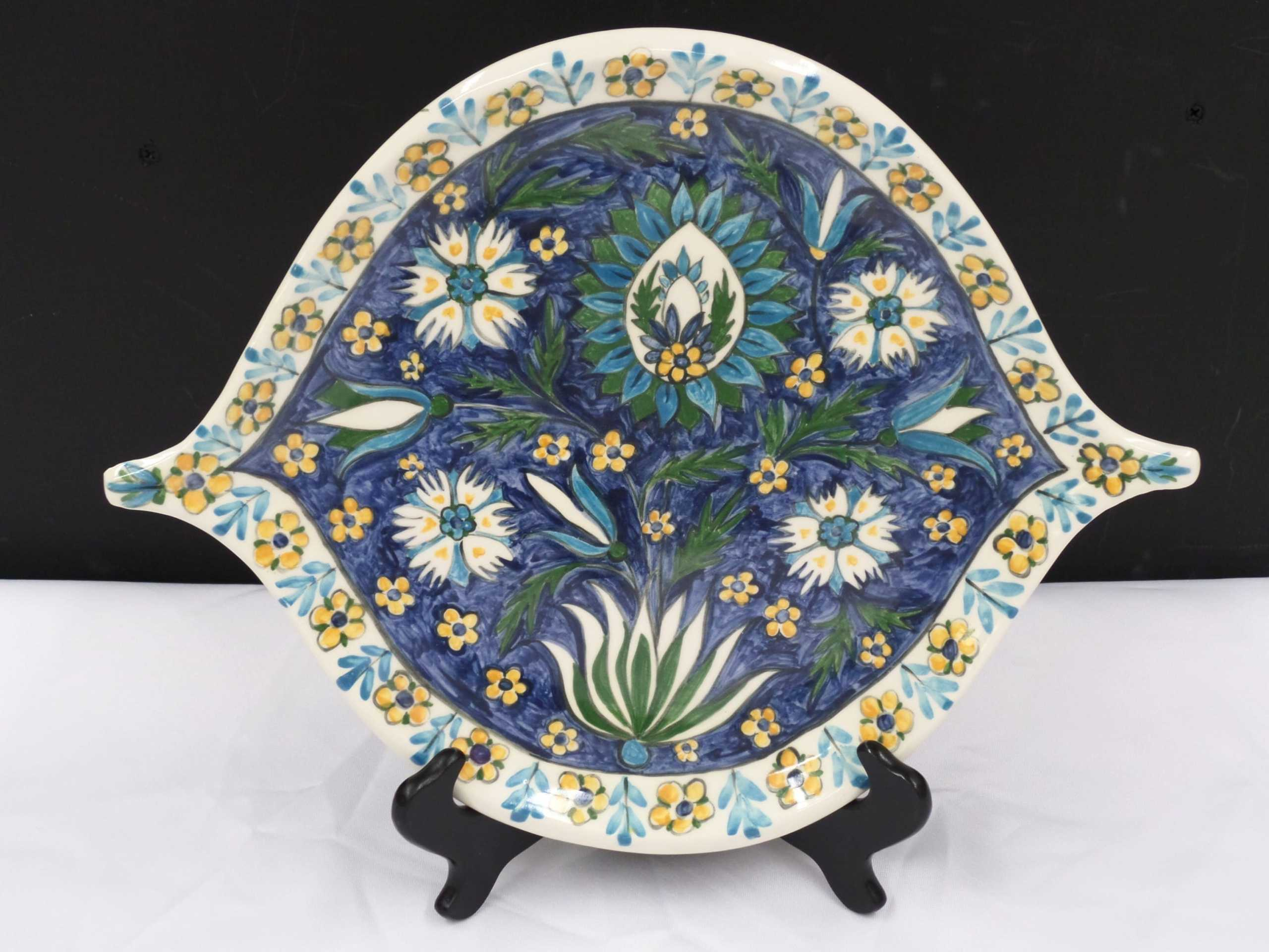 """11"""" FLORAL CERAMIC PLATE  Donated by: ARTIST URSULA MICKLE  Valued at: $80"""