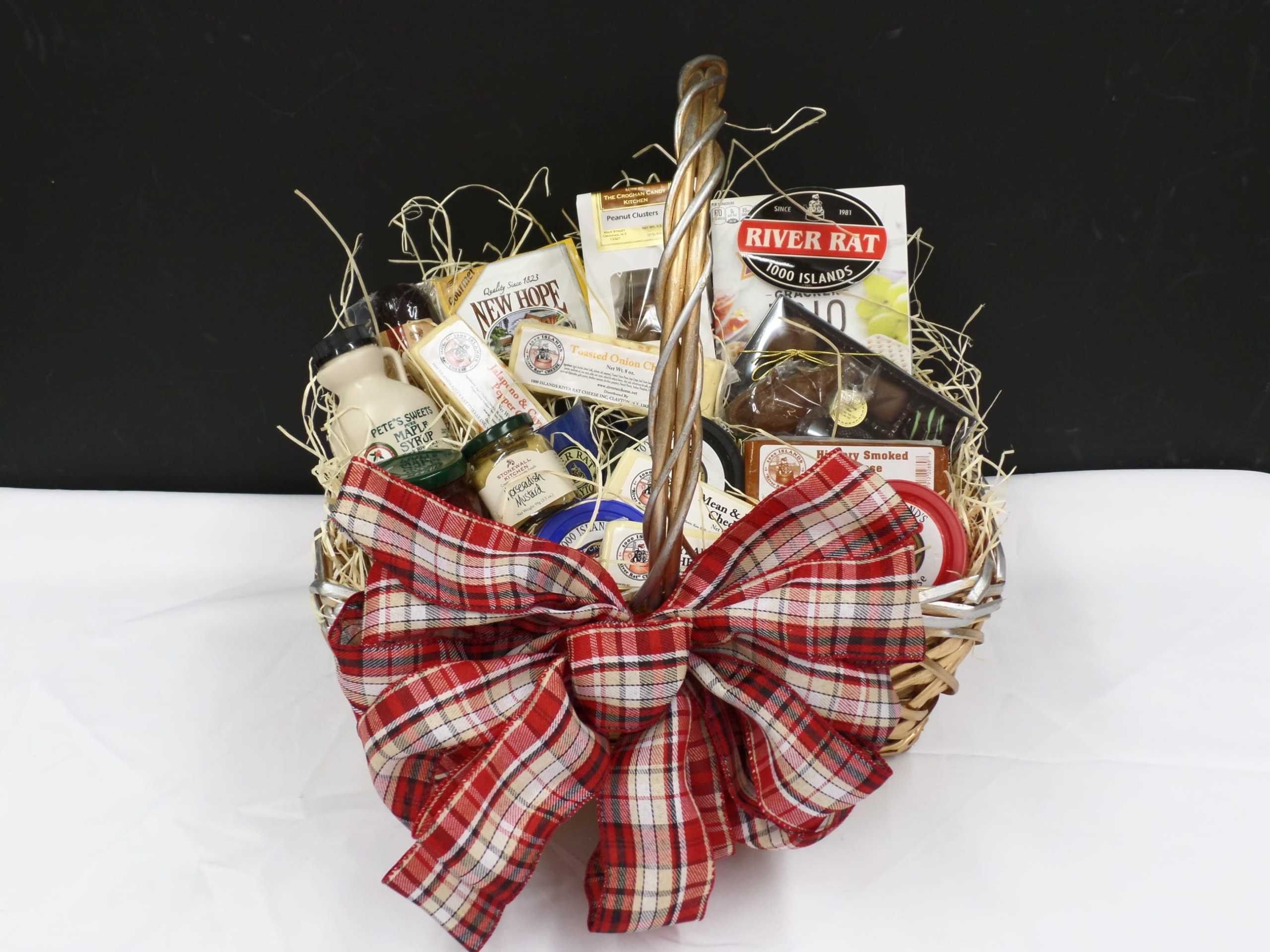 FESTIVE GIFT BASKET <br/> Donated by: 1000 ISLANDS RIVER RAT CHEESE <br/> Valued at: $100