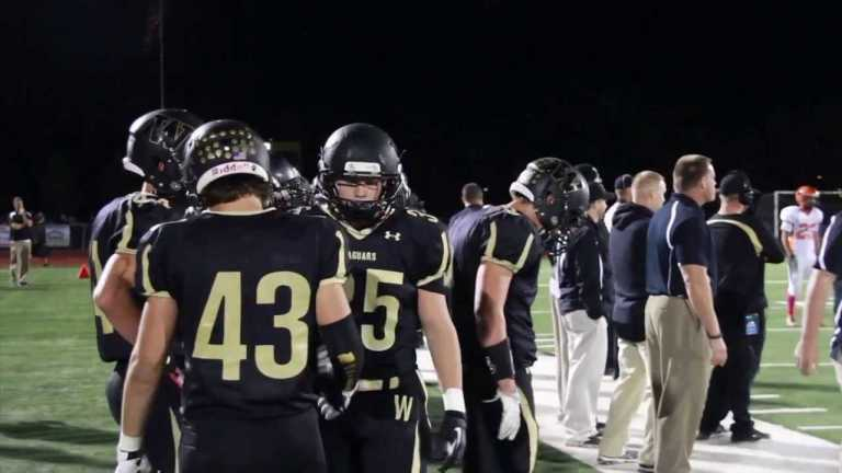 Parents and teens weigh concussion risks and love of football