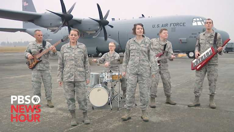 Military musicians sing 'Carol of the Bells'