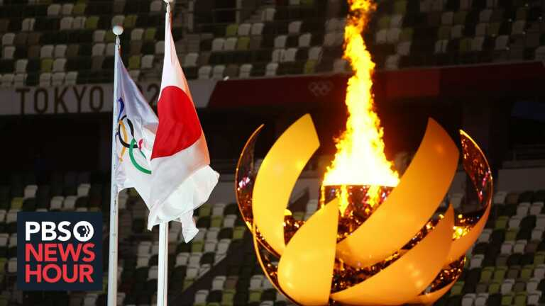 Quiet Olympics opening ceremony sees loud public protest over virus concerns