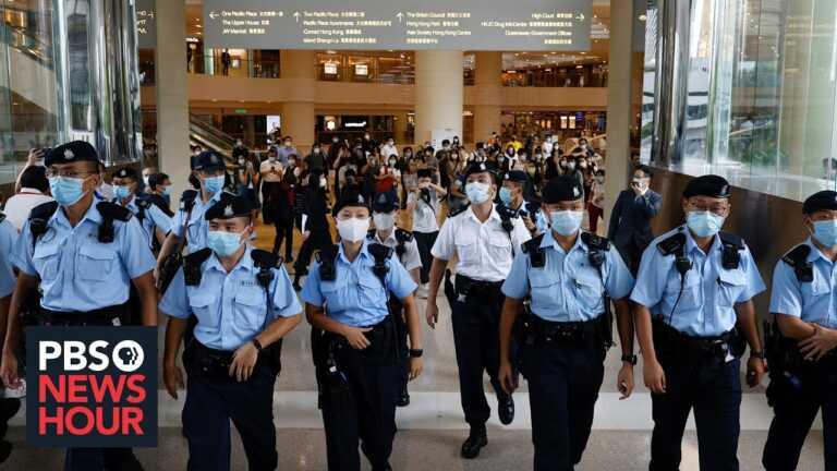 Hong Kong residents worry vague new immigration law could let China ban them from leaving